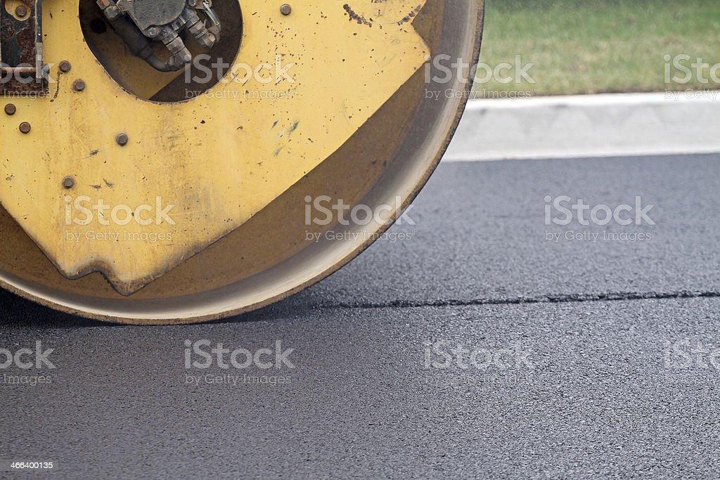 Compressing Hot Asphalt, Closeup royalty-free stock photo