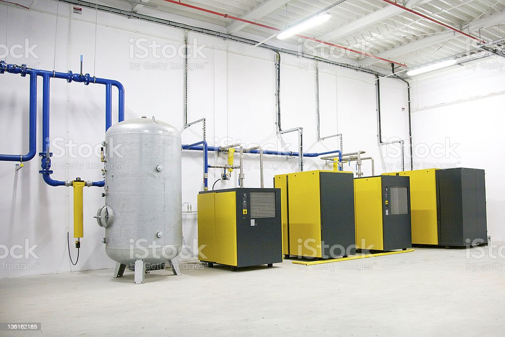 A compressor station with yellow and black equipment stock photo
