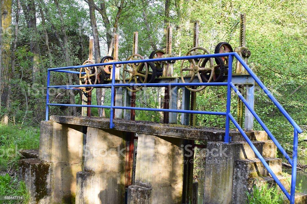 Compuerta del canal de riego / Irrigation channel floodgate stock photo