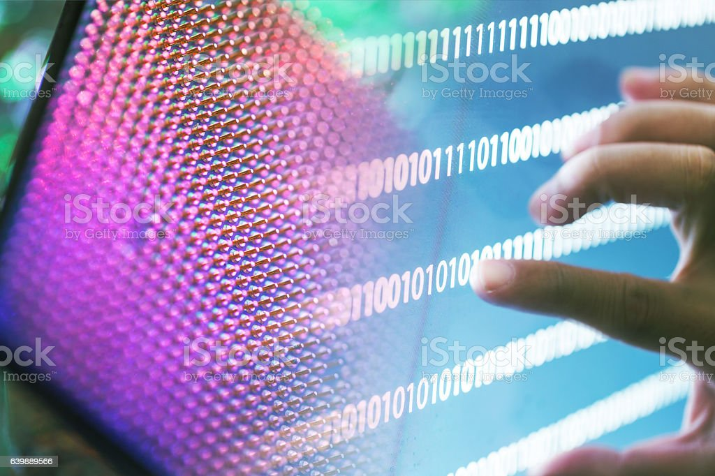 compurter CPU with binaray numbers stock photo