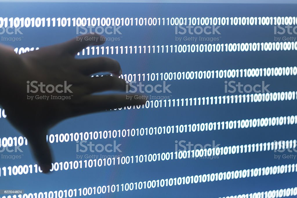 compurter screen with binaray numbers stock photo