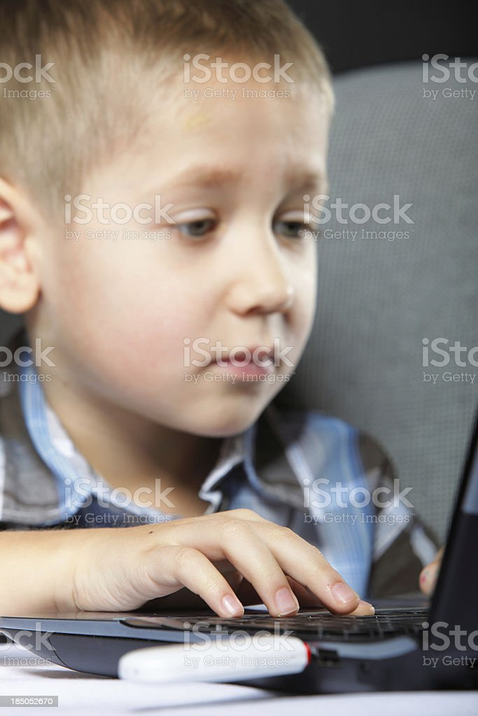 Computer addiction child with laptop notebook royalty-free stock photo