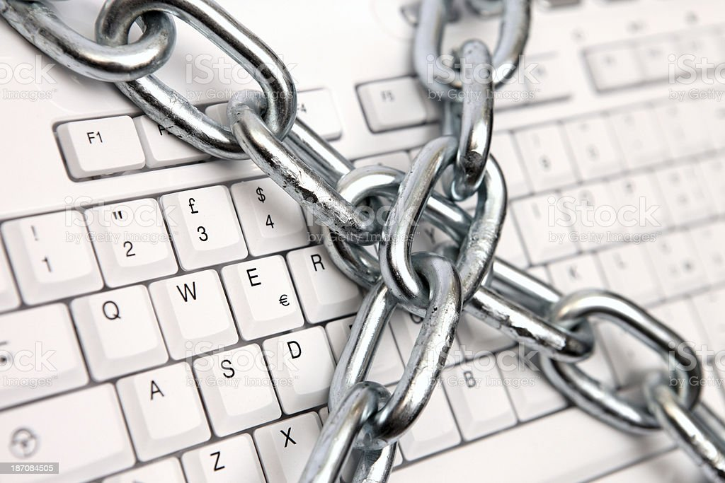 Computer and data protection with a steel chain royalty-free stock photo