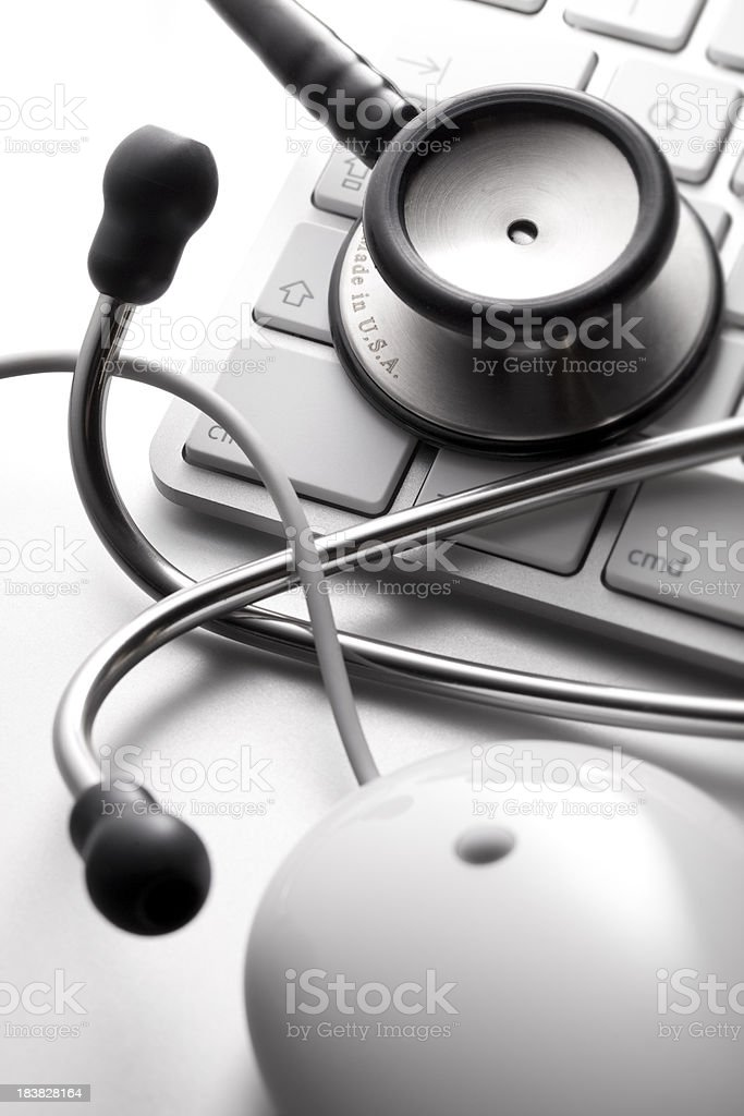 Computer and stethoscope stock photo