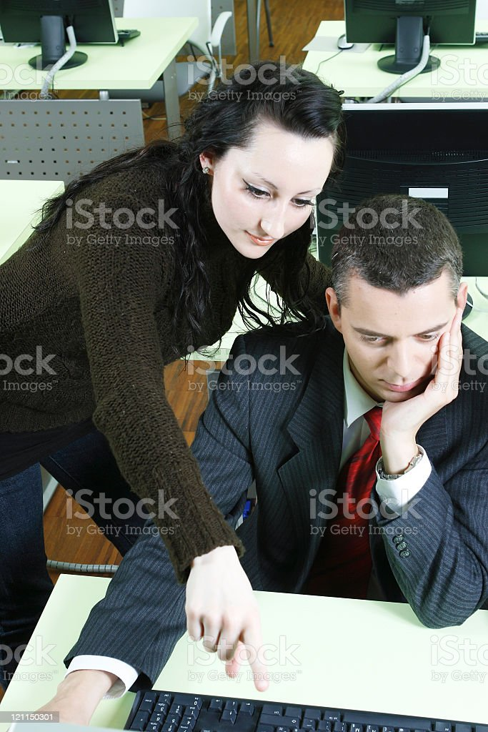 Computer Class with Business Man taking a lesson. royalty-free stock photo
