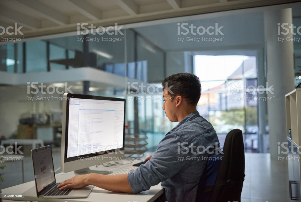Computer coding? That's where he comes in stock photo