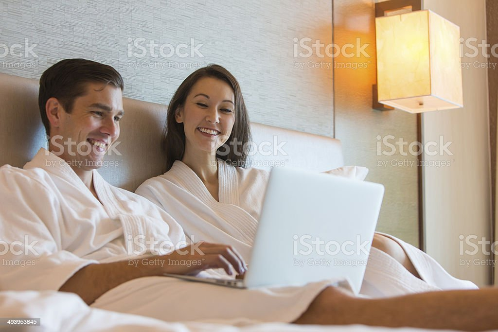 Computer Couple in Bed royalty-free stock photo