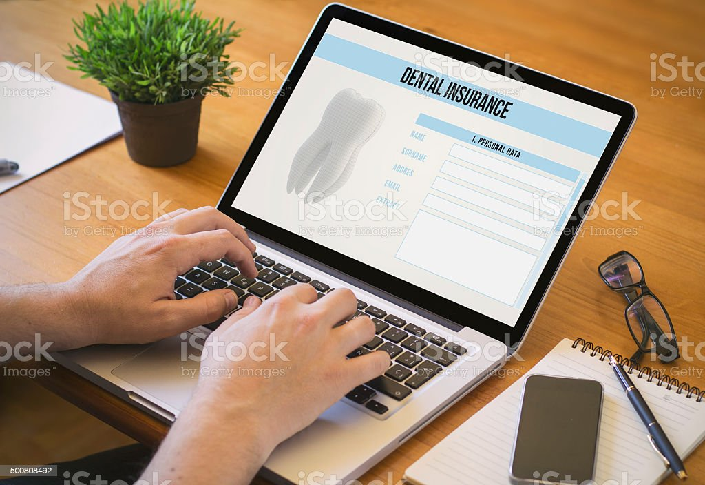 computer desktop dental insurance stock photo