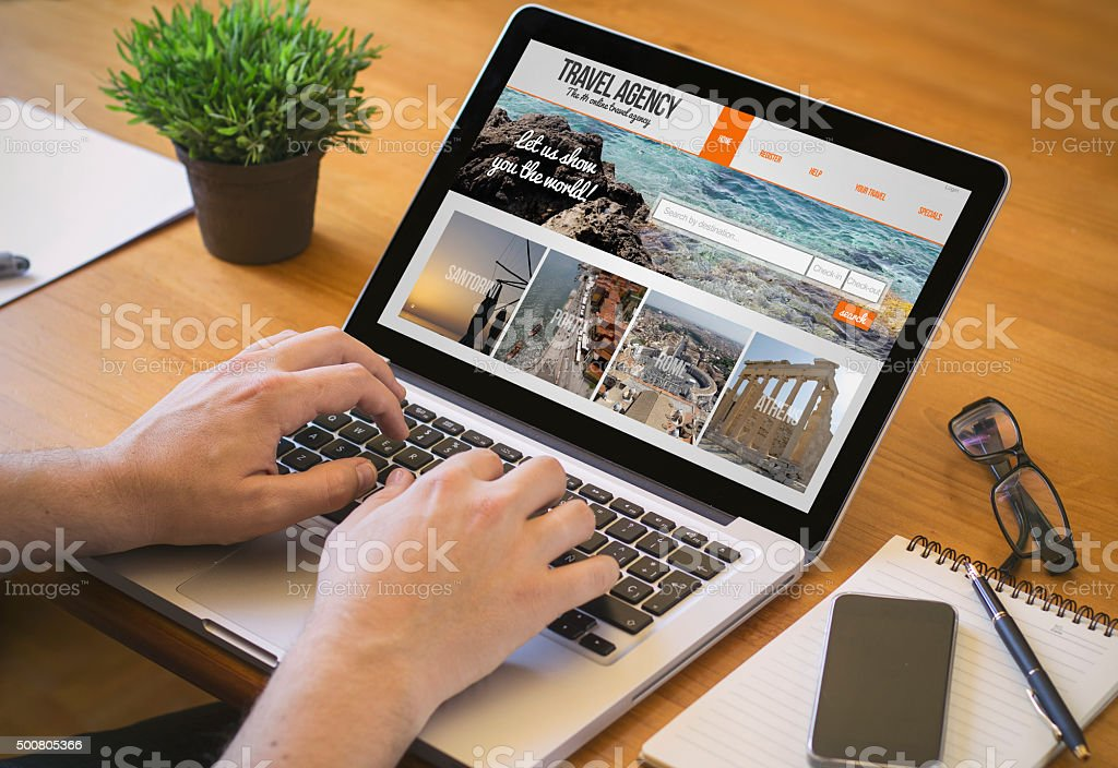 computer desktop travel agency stock photo