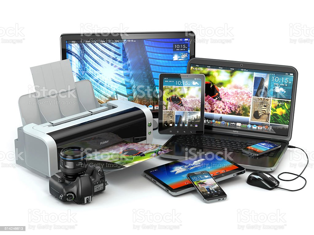 Computer devices. Mobile phone, laptop, printer, camera and tabl stock photo