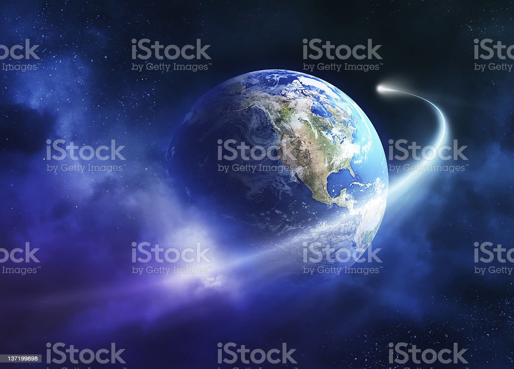 Impression of comet passing planet earth stock photo