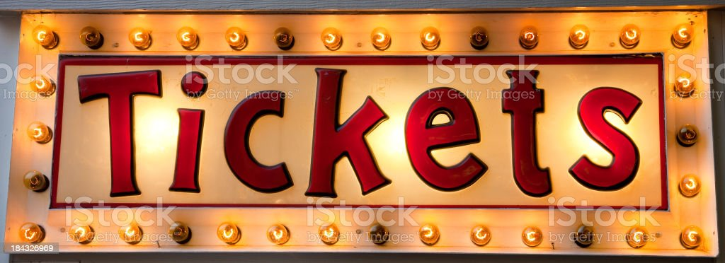 Computer graphic Tickets sign illuminated by light bulbs stock photo