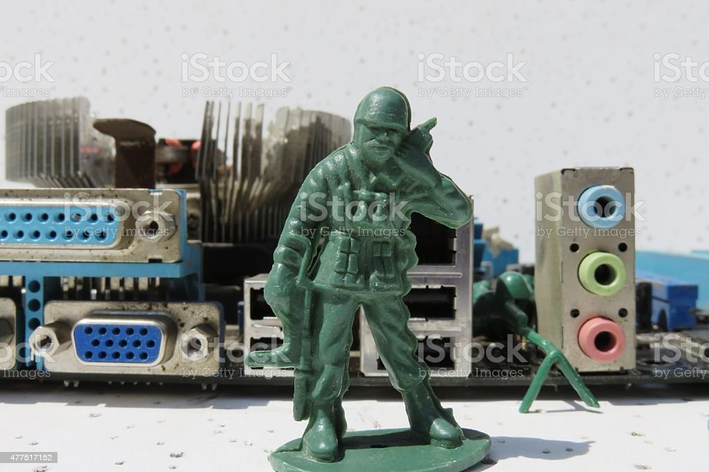 computer guarded by plastic toy stock photo