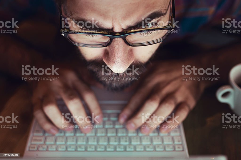 Computer hacker stealing information with laptop stock photo