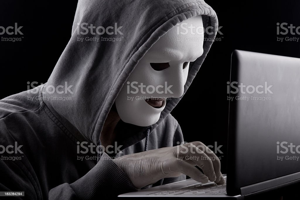 Computer Hacker With Mask Pressing Komputer Buttons royalty-free stock photo