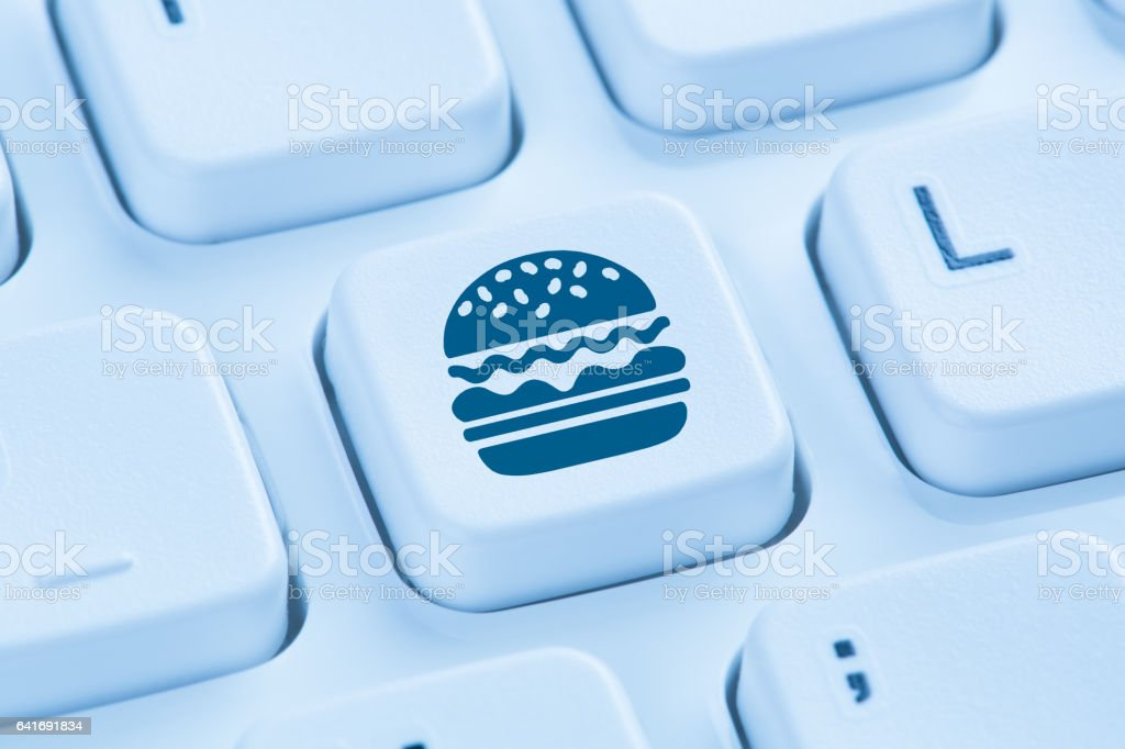 Computer hamburger cheeseburger fast food ordering online order delivery stock photo