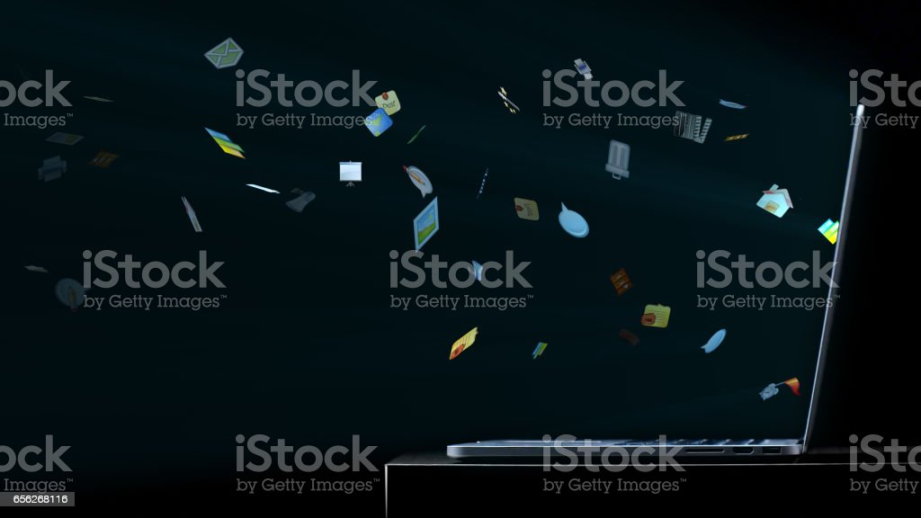 Computer icons flying of the monitor of a laptop stock photo