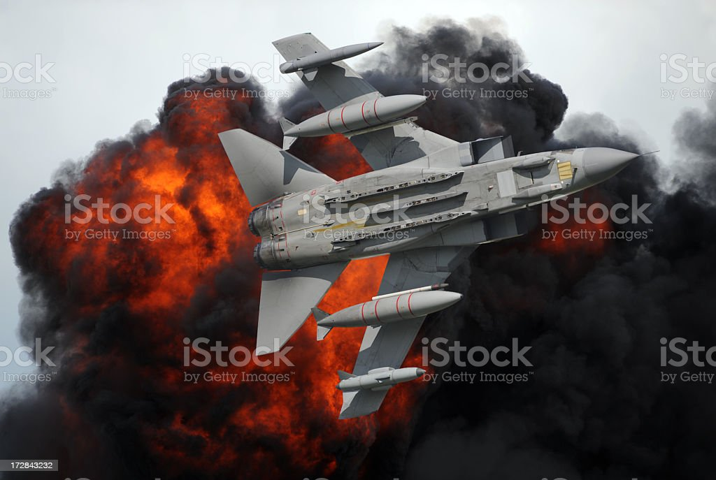 A computer image of a fighter jet in front of a fiery burst royalty-free stock photo