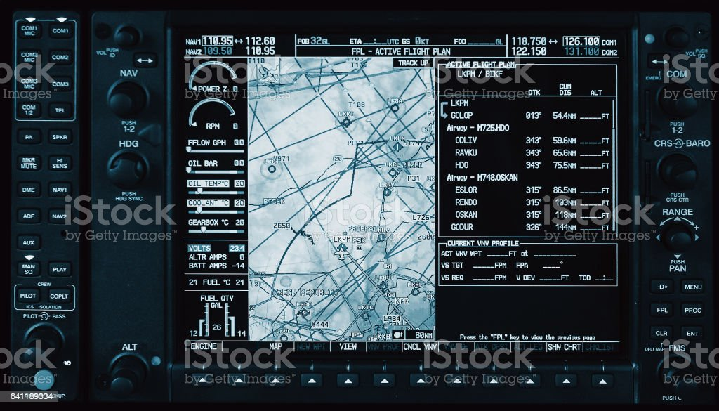 Computer in cockpit. Airplane glass cockpit display with weather radar and engine gauges  in small private airplane stock photo