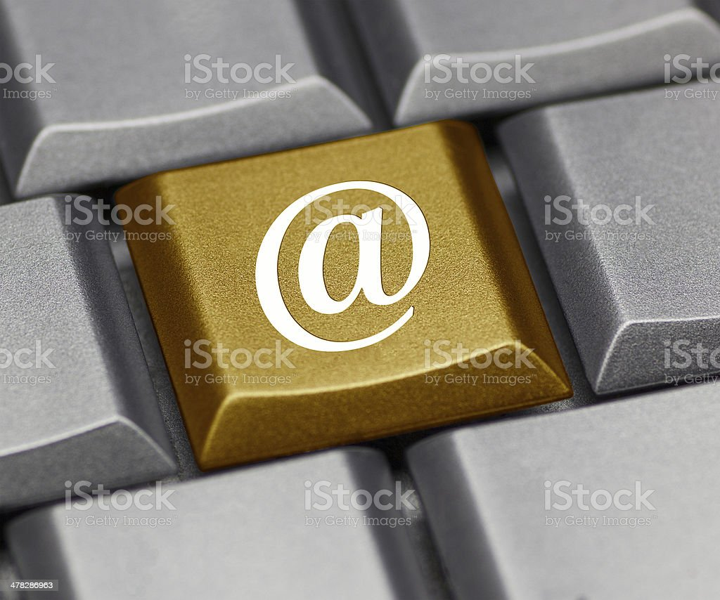 Computer key golden - @ symbol royalty-free stock photo