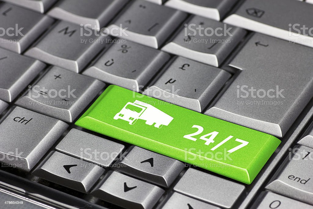 Computer Key green - 24/7 with truck symbol royalty-free stock photo