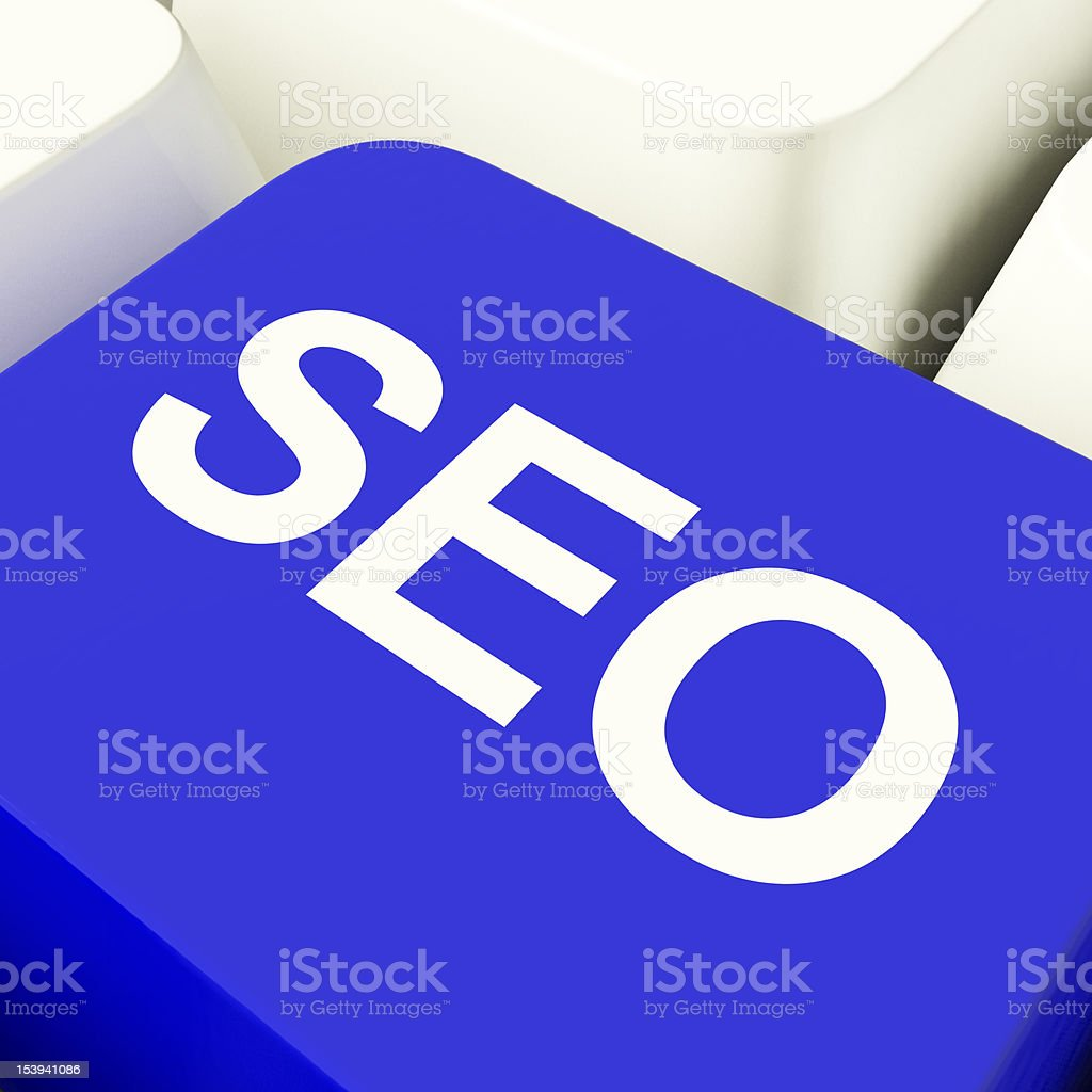 SEO Computer Key In Blue Showing Internet Marketing And Optimiza royalty-free stock photo