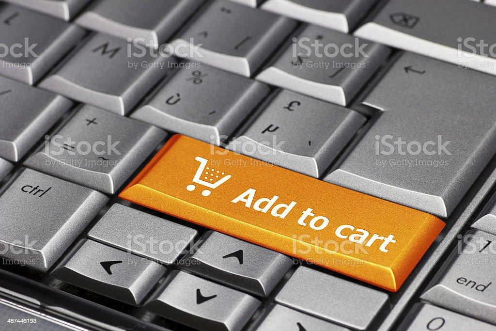 Computer Key orange - Add to cart stock photo