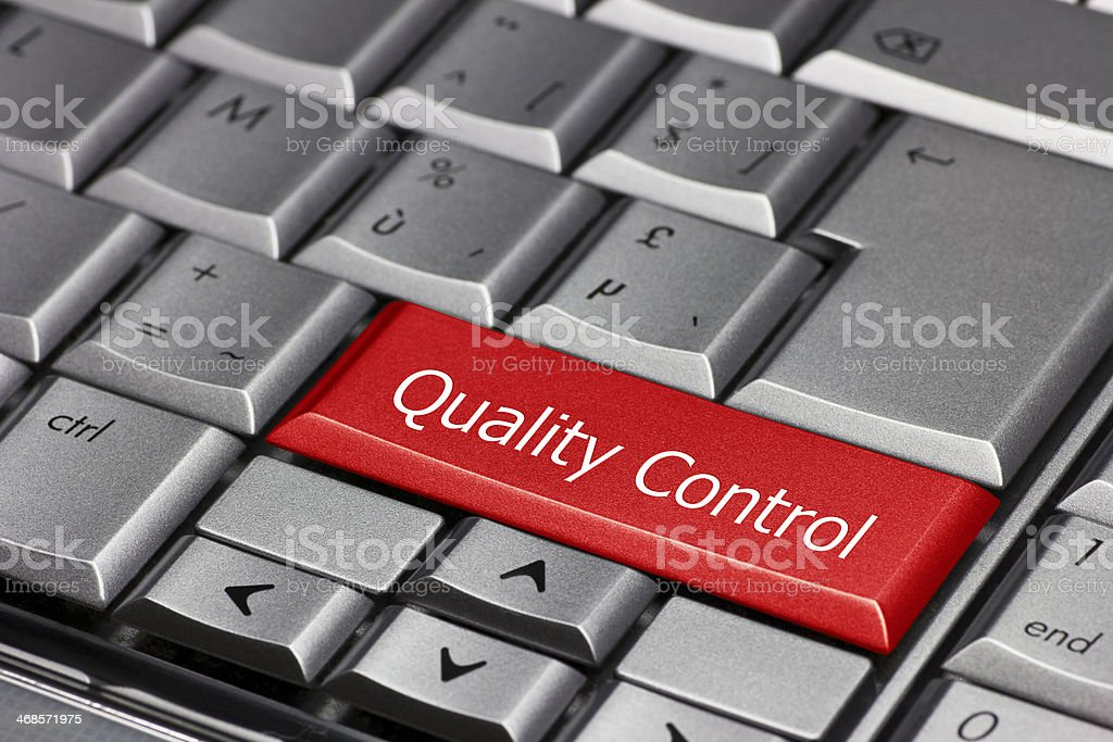 Computer key - Quality Control stock photo