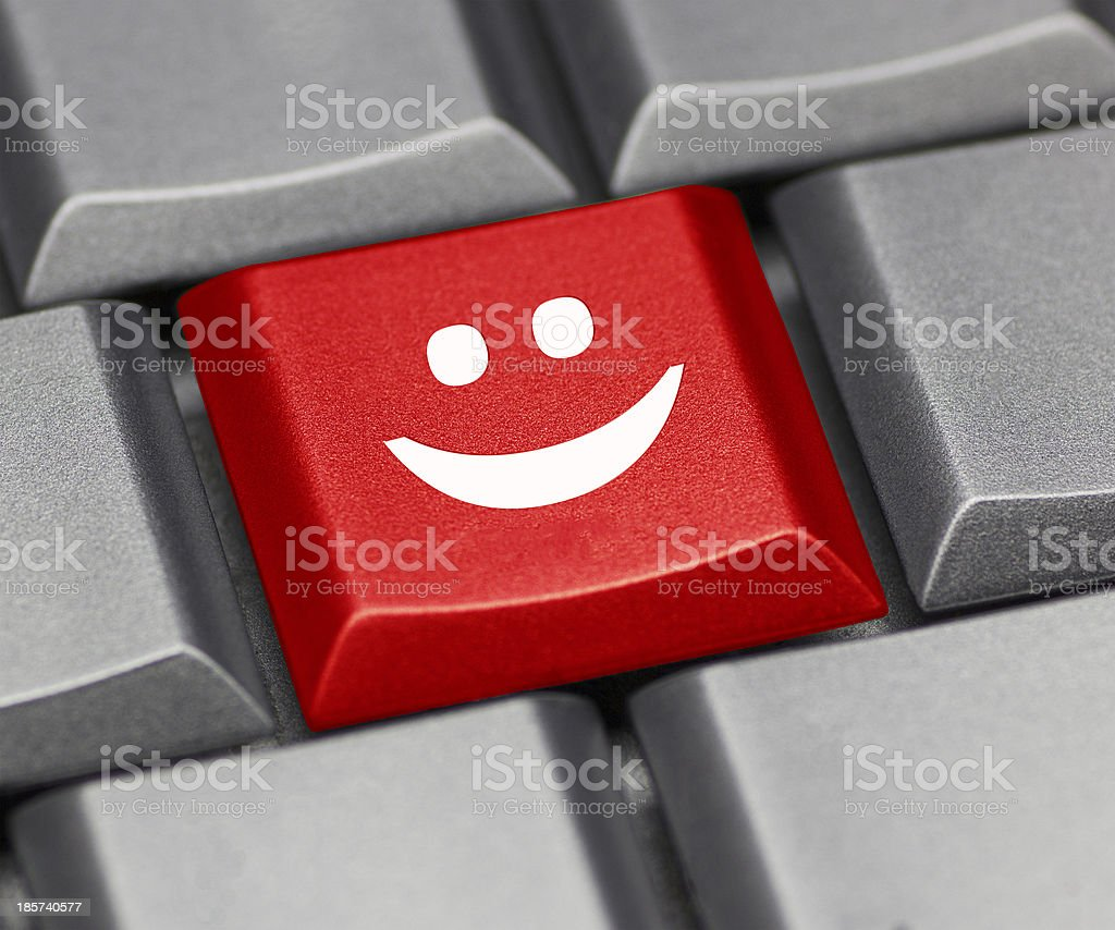 Computer key red - happy smiley royalty-free stock photo