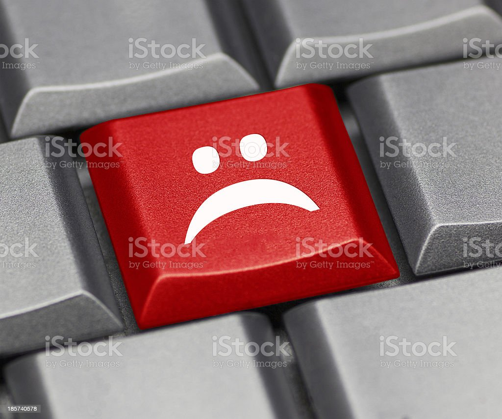 Computer key red - unhappy smiley royalty-free stock photo