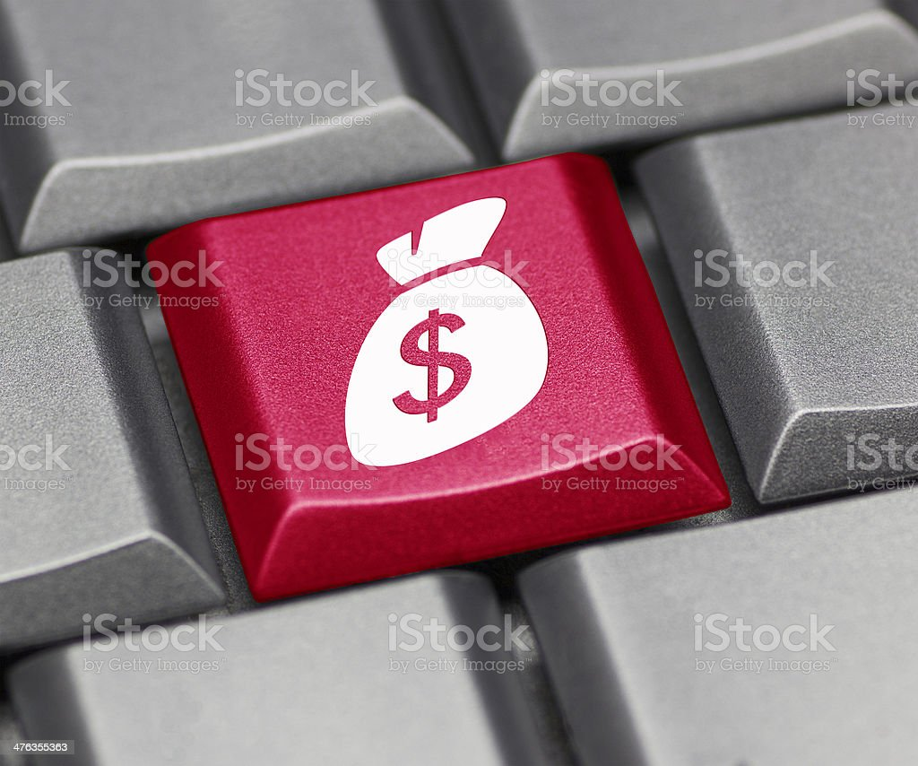 Computer key with dollar sign and purse royalty-free stock photo