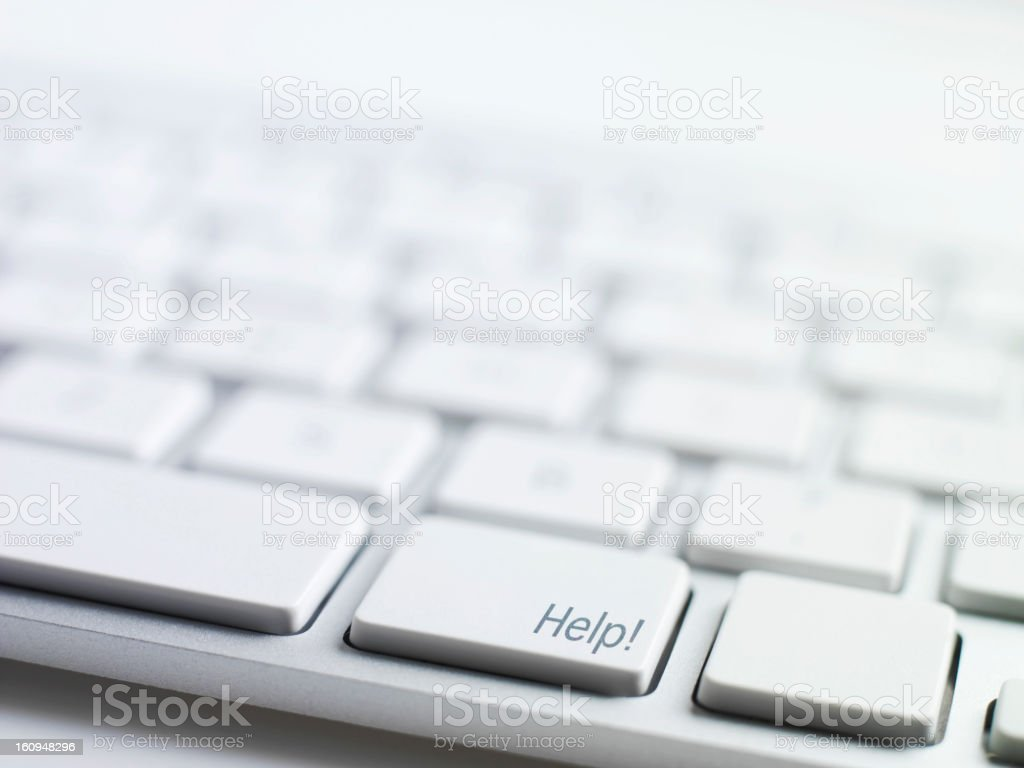 A computer keyboard concept with a key for Help royalty-free stock photo