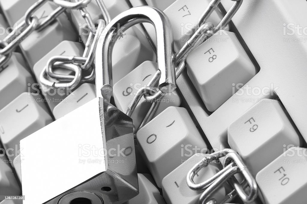 Computer  keyboard secured with chain and padlock royalty-free stock photo