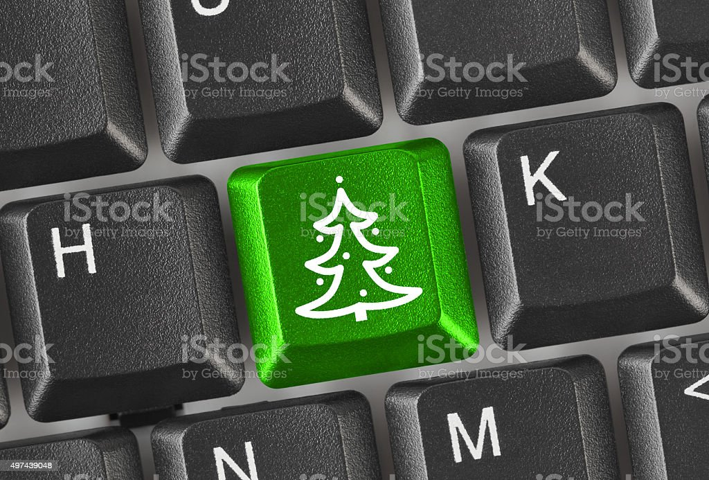 Computer keyboard with Christmas tree key stock photo