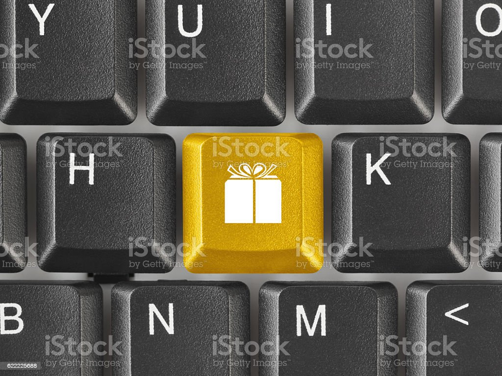 Computer keyboard with gift key stock photo