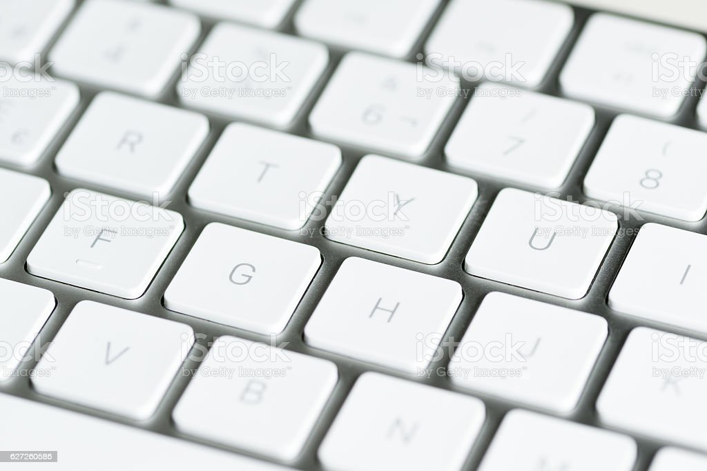computer keyboard with keys in the foreground on table stock photo