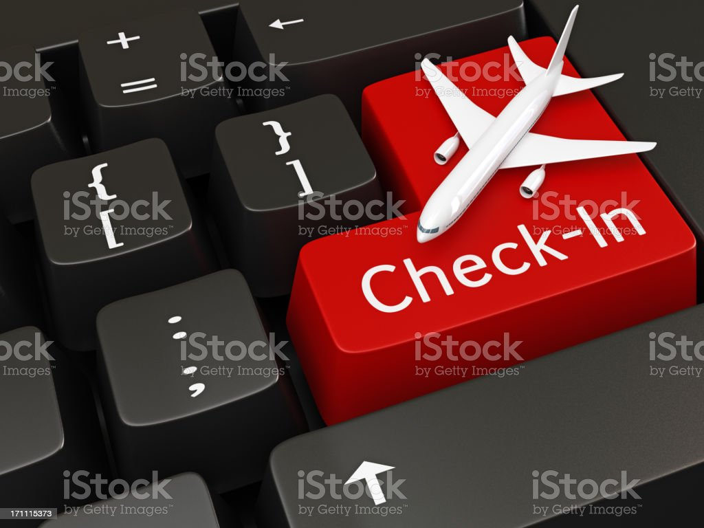 Computer keyboard with red check in key with airplane on royalty-free stock photo