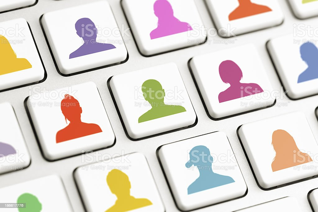 Computer keys with colored avatars royalty-free stock photo