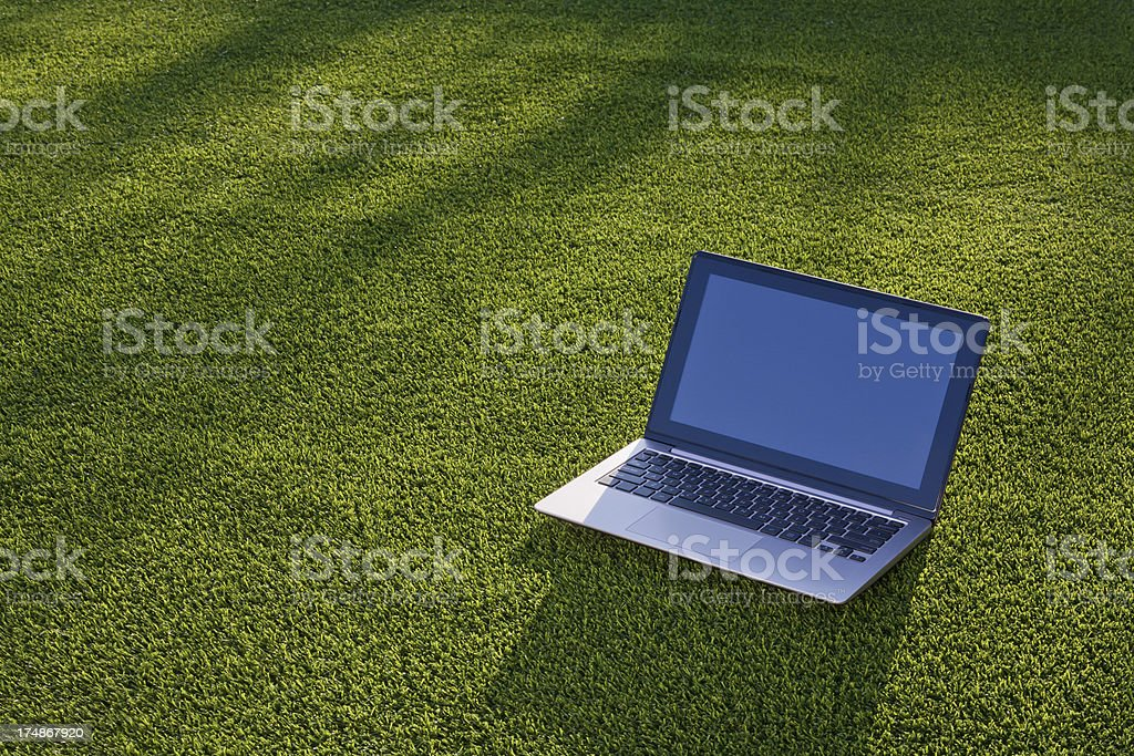 Computer laptop on artificial turf royalty-free stock photo
