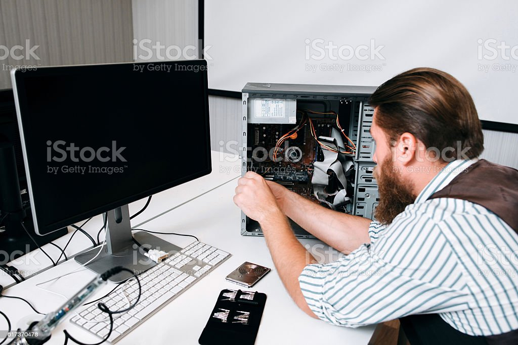 Computer master disassembling CPU with tools stock photo