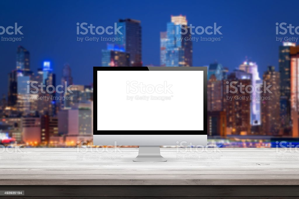 computer monitor on wooden desk city sky line stock photo