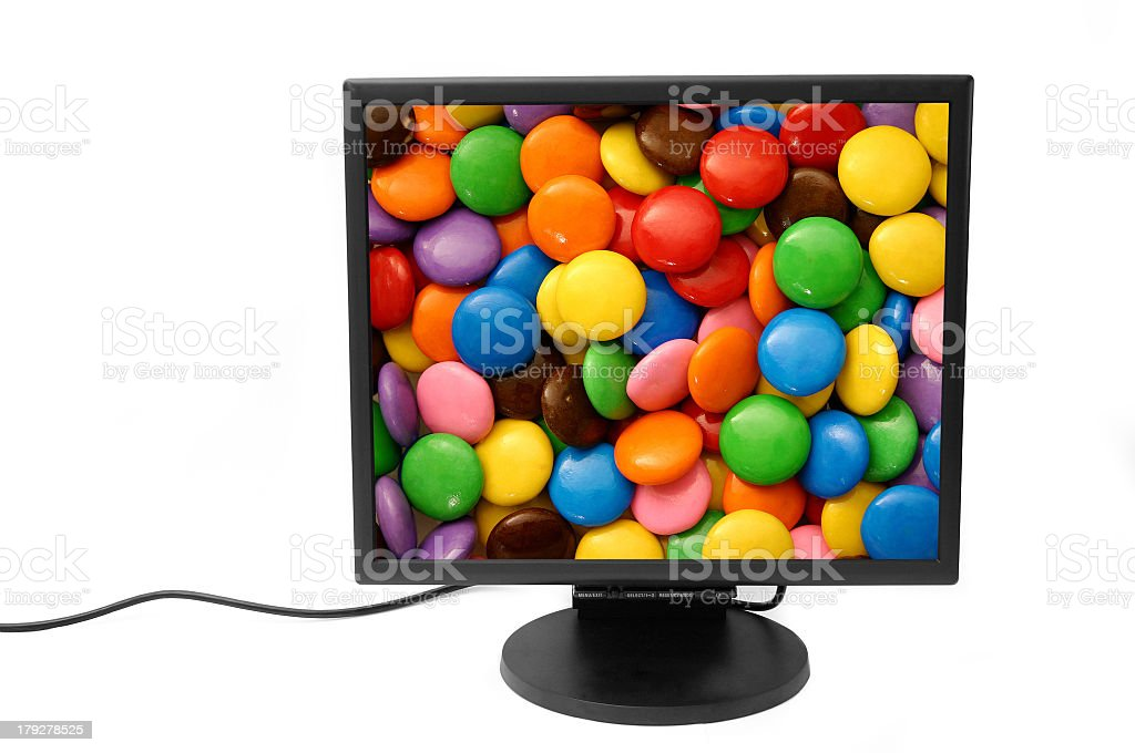 A computer monitor showing colorful chocolates stock photo