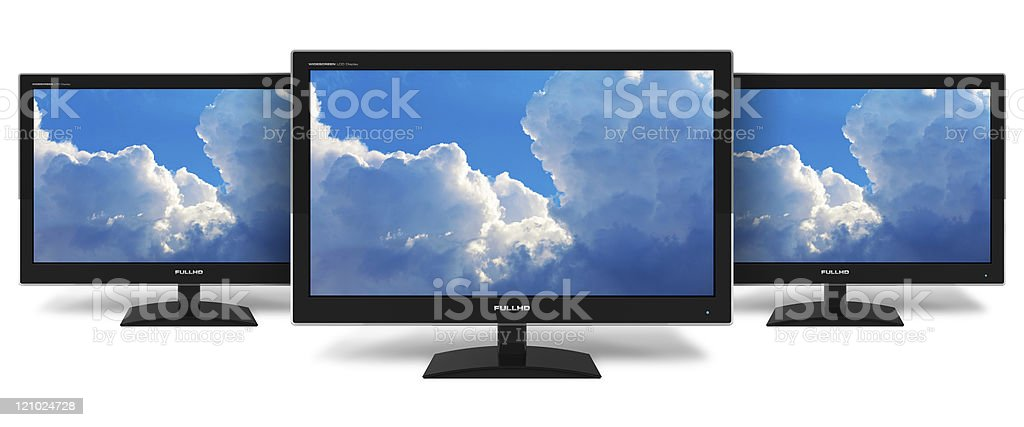 Computer monitors displaying clouds stock photo