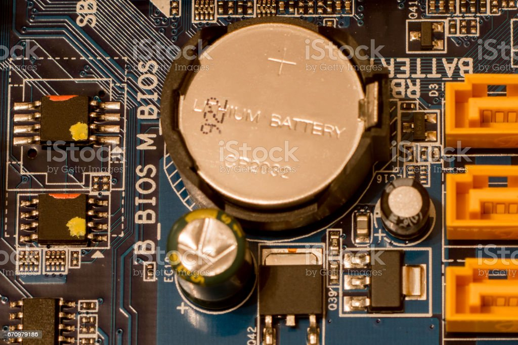 computer motherboard clock battery stock photo