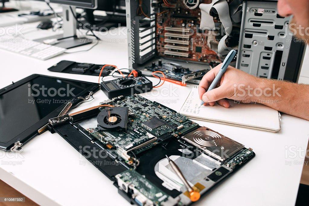 Computer motherboard diagnostics, close-up stock photo