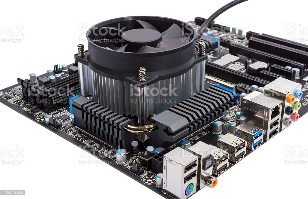 Computer motherboard with CPU cooler stock photo