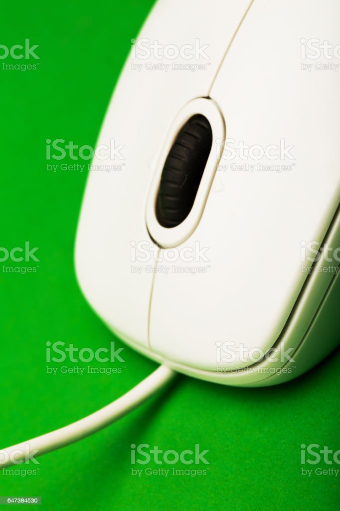 computer mouse isolated on green stock photo