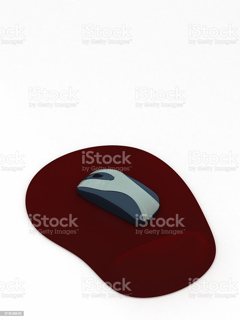 Computer mouse on red pad royalty-free stock photo