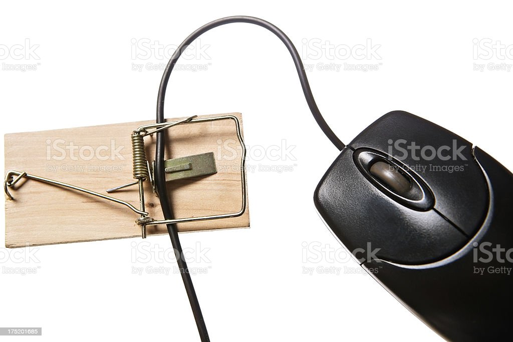 Computer mouse trapped in traditional mousetrap royalty-free stock photo