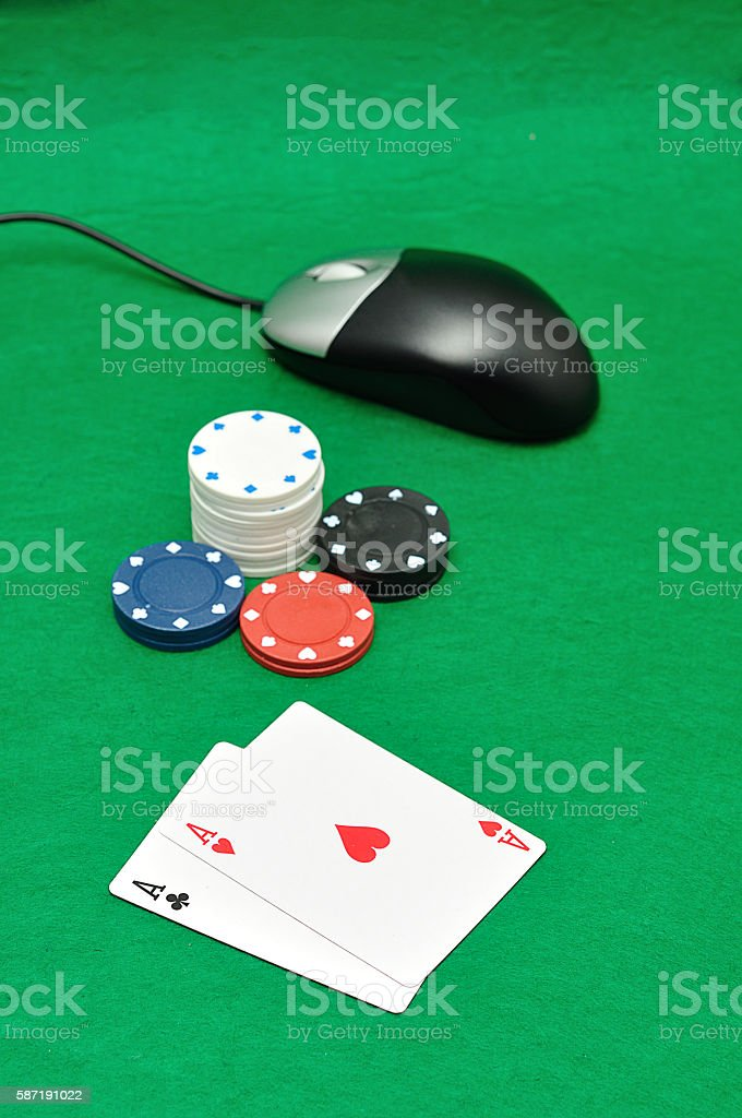computer mouse with poker chips and playing cards stock photo